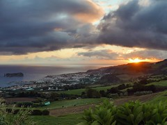 beautiful sunset (ekelly80) Tags: azores portugal sãomiguel october2018 fall view vilafrancadocampo sunset sun town evening light night sky clouds colors pasture hills green grass island cows ocean water atlanticocean