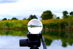 Blurred Perceptions..A tripod can also hold your idea (Eat With Your Eyez) Tags: landscape late summer color lensball reflection mirror image panasonic fz1000 medina county ohio killbuck lake water pond sky tripod
