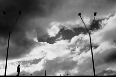 Arriving on earth (pascalcolin1) Tags: paris13 homme man ciel sky lampadaires lamppost lumière light nuages clouds photoderue streetview urbanarte noiretblanc blackandwhite photopascalcolin 50mm canon50mm canon