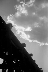 Late Afternoon Clouds at the Rocksprings Trestle (squirtiesdad) Tags: rocksprings train trestle clouds mojave river diyfilmscanning selfdeveloped photak foldex 63 epson v600 blackandwhite bw analog analogue arista aristaedu iso100 120 film