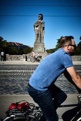 Opposite directions (iamunclefester) Tags: münchen munich street bike bicycle bridge maximiliansbrücke maximilianeum sunglasses statue blue sky tracks cobblestone profile asatouristinmyhometown dof opposites direction manualfocusday manualfocus