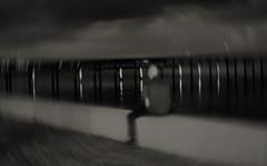 To jump or not to jump (Twila1313) Tags: jump river bridge pier seawall water dark night swirling dizzy effect ill suicide dream delusion monochrome blackandwhite blackwhite sonynex5n industar502f35