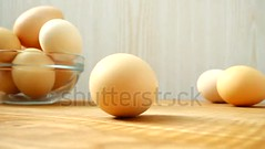 Turning egg. Shooting in kitchen. (daria.boteva) Tags: wooden background breakfast egg brown eggs chicken closeup cooking farm food fragility fresh freshness group hay healthy eating heap hen ingredient life natural nature organic poultry protein raw rural rustic table white wood yellow yolk basket cuisine eggshell fragile kitchen light board easter eat meal turning turn spins rotates