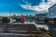 Peggy's Cove, Nova Scotia (Chriskellyphotography) Tags: atlanticocean peggyscove fishingvillage landscape fishingboat reflection sea seaweed dock boat boats clouds cityscape coast novascotia nikkor20mm famousplaces warf touristlocation ocean