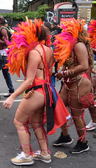 DSC_8420a Notting Hill Caribbean Carnival London Exotic Colourful Orange and Pink Costume with Ostrich Feather Headdress Girls Dancing Showgirl Performers Aug 27 2018 Stunning Ladies Delightful Fine Ass (photographer695) Tags: notting hill caribbean carnival london exotic colourful maroon orange pink costume with ostrich feather headdress girls dancing showgirl performers aug 27 2018 stunning ladies delightful fine ass