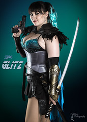Sucker Punched 4 - Glitz (FightGuy Photography) Tags: sword suckerpunched cosplay cosplayer bernadettebentley bernadette fightguyphotography bangs teal katana weapon pistol corset sparkle skirt fishnets armor cape
