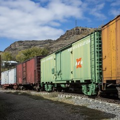 Color Boxes (trainmann1) Tags: nikon d7200 nikkor amateur handheld co colorado october oct 2018 fall train trains track tracks rail rails railroad museum americanrailroadmuseum coloradorailroadmuseum exterior outside outdoors goldenco boxcars boxcar colorful colors yellow green red blue white brown rocks stones ballast coupled reaexpress