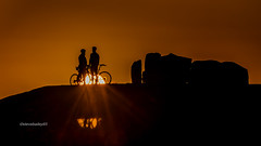 A biking good sunset (stevenbailey7) Tags: bikers cyclists cyclist bike bikes bikerider pushbike pushbikerider pushbikeriders bicycle twowheeler bicycles wheels reflections sunrays sun sunsets sunset coast coastal october nature new light landscape sky red redsky sunlight stones silhouette silhouettes shadows sundown dusk twilight afternoon orange sunsetsky people men naturephotography travel nikkor flickr wales cymru walessunsets welshsunsets walescoast colour colourful nikon serene view figures skyscape weather home
