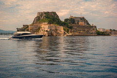 Coasting in Ionia..... (Dafydd Penguin) Tags: coast coasting yacht yachting boat boating ship vessel speedboat motoryacht castle water sea fort hill town ancient mediterranean ionian island corfu greece sailing sailboat cruising cruise leica m10 7artisans 50mm f11 noctilux