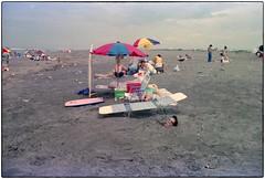 Beach scene - 1980s (Peter Bellars) Tags: japan 1990s beach buried forgotten odd strange surreal