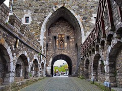 Ponttor medieval city gate, c1375  - Aachen, North Rhine-Westphalia, Germany. (edk7) Tags: olympuspenliteepl5 edk7 2015 germany deutschland northrhinewestphalia nordrheinwestfalen aachen citywallsouterring ponttor citygate c1375 stonecarving sculpture architecture building oldstructure arch stone ashlar unescoworldheritagesite medieval architrave pavement road wall cityscape city urban