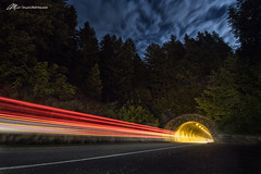 Death Ray from the Mountain (Matt Straite Photography) Tags: night dark lights long shutter longexposure tunnel mountain cars streak red blue sky clouds landscape tripod canon tamron oregon vernonia 26 highway road street trees forest cave color