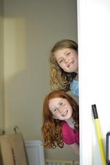 looking around the corner (l i v e l t r a) Tags: candid looking peekaboo girls kids play fun corner 85mm f2 sunlight