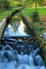 Flow through (myraemery) Tags: river reflections long exposure trees grass water autumn colours leaves canoneos70d 1755mm bournemouth dorset gardens bourne