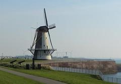 Oranjemolen, windmill in Vlissingen (joeke pieters) Tags: 1430655 panasonicdmcfz150 vlissingen walcheren zeeland nederland netherlands holland oranjemolen windmolen windmill hek fence hff