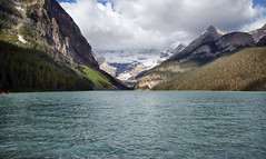 Lake Louise, Banff National Park #2 (crafty1tutu (Ann)) Tags: travel holiday 2018 canadaandalaska canada lakelouise banffnationalpark mountain mountains mountainrange mountainside water lake bluewater sky clouds snow tree trees forest crafty1tutu canon5dmkiii canon24105lserieslens anncameron grass landscape boat