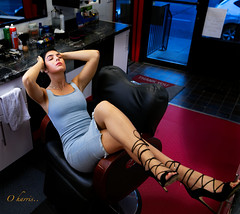 0H3A9616 (O Harris) Tags: brunette green eyes fit model long legs black heels highheels bare arms armpit fashion glamour piercing nose ring gold chain salon barbershop mirror red carpet chair tight dress canon 5ds canada ottawa slit redlips makeup