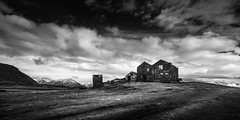 Abandoned Icelandic Farmhouse (Mabry Campbell) Tags: europe iceland scandinavia southiceland southerniceland abandoned architecturalphotography architecturephotography blackandwhite coast coastal dark farm farmhouse fineartphotography image landscape moody mountains nopeople old photo photograph photography spooky f80 mabrycampbell april 2013 april152013 201304150h6a0815 17mm ¹⁄₆₄₀sec 100 ef1740mmf4lusm fav10 fav20 fav30 fav40 fav50