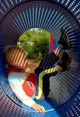 Lights (SurFeRGiRL30) Tags: playground lightsshadows tunnel play playing kid child fun afternoon sun sunshine myson mine holed