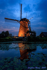 "Nederward no. 6 during ""Kinderdijk Verlicht"" (Stephan Neven) Tags: mill kinderdijk verlicht enlighted blue hour nederwaardno6 netherlands polder landscape water reflection lily molen blauw lucht light sky outdoor bridge shed"