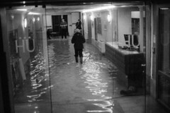 soulèvement (asketoner) Tags: hotel flood acqua alta venezia italy man walking corridor hall entrance doors interior water analog