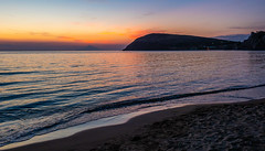 A Lemnos Beach at Sunset ( Mount Athos in the distance) Myrina Town - Limnos  (Olympus OM-D EM1-II & M.Zuiko 12-40mm f2.8 Pro Zoom) (1 of 1) (markdbaynham) Tags: greece greek limnos lemnos sunset seascape settingsun sun colour grecia greka hellenic hellas greekisland greekholiday greeceaegean aegean northaegean northaegeanisland sky travel greeksunset mft olympusmft olympus omd olympusomd olympusem1 m43 mzd mz zd zuikolic em1 em1ii em1mk2 csc mirrorless microfourthird microfourthirds olympusprolens prozoom zuikopro micro43 m43rd myrina mypina myrinatown landscape athos mountathos 1240mm f28 greekcoastline evil em1mark2