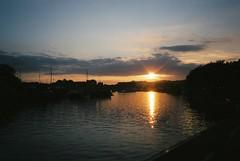 Sunset on the Floating Harbour - walking home the long way round (knautia) Tags: floatingharbour bristol england uk october 2018 film ishootfilm olympus xa2 olympusxa2 fuji superia 400iso nxa2roll89 sunset lensflare harbour docks sky reflection