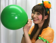 She Knows She Made Us Watch (emotiroi auranaut) Tags: girl woman lady model gorgeous beautiful pretty adorable attractive female feminine femininity halloween pumpkin orange green toy balloon air fun tease teasing play playing playful braces smile grin grinning giggle giggling smiling