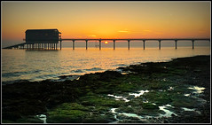 Sunrise, Bembridge (Jason 87030) Tags: beach coast sea light color colour bembridge iow island isleofwight 2018 october holiday walk mornign early sun rise weather rnli pier lifeboat station sand water waves sky structure solhouette