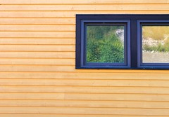 In the Window (Karen_Chappell) Tags: quidividi window building yellow reflection reflections architecture clapboard wood wooden paint painted stjohns newfoundland nfld avalonpeninsula atlanticcanada eastcoast trim lines geometry geometric rural green blue