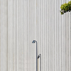 Dash of green (Arni J.M.) Tags: architecture building dashofgreen lamppost shadow lines branches leaves green wall facade vertical magasin kongenslyngby denmark