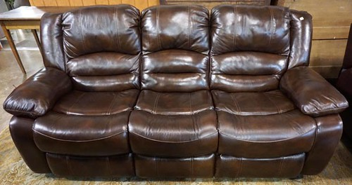 Brown leather reclining sofa ($784)