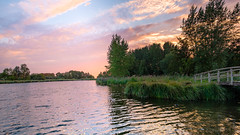 Sunset on the border of the municipality of Delft (FotoCorn) Tags: bridge peaceful romantic reflection orange multicoloredsky rotterdam summer outdoors white view water netherlands multicolor trees nature ruralview sunshine delft sunset rural evening sunlight countryside sky colorful scenery beautiful panoramic middendelfland clouds landscape