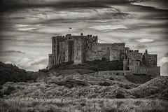 Bamburgh Castle (Evoljo) Tags: bamburghcastle castle northumberland blackwhite old sky uk walls keep moat clouds nikon d500