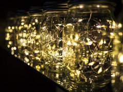 Mason Jar Fairy Lights (joncutrer) Tags: warm led fairylights mason jar jars glass light reflection dof bokeh shelf lights dark