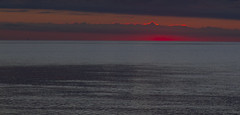 Red Sky, Metallic Sea (brucetopher) Tags: sunset ocean red glow afterglow cloud ripple wet water beach still peace peacefull minimal simple bay cove cape sky skies weather
