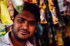 Shopkeeper Among Wares, Uttar Pradesh (AdamCohn) Tags: adam cohn uttar pradesh india mathura vrindavan holi wwwadamcohncom adamcohn uttarpradesh