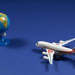 Travel theme with miniature airplane and globe thumbnail