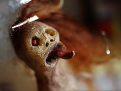 Flickering tongue (Twila1313) Tags: primitivedoll primitivefigurine primitivestatue clayfigure olddoll ancientfigure old ancient primitive spirit tribe legend devil handmade artdoll sonya7ii minolta50mmf35macro