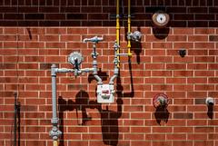 'The Da Vinci Code' (Canadapt) Tags: brick wall meter pipe alarm shadows valves graphic timmins canadapt
