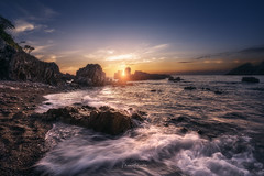 Illuminated Double Axe (Manuel.Martin_72) Tags: asturien spain cudillero enchanting lightdrama magic coast rocks sand stones ocean reflections sea water waterreflections waves bluesky clouds sun evening sunset wbpa asturias