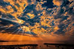 Sunset's Beacon - Faro, Portugal (mikederrico69) Tags: sunset sunrise sunrays sun summer skyline sky clouds shoreline sea ocean marina boats sailboat colorful orange seaside seascape oceanscape vacation portugal algarve panaramic travel trip europe beach rays