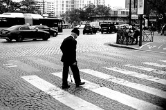 In front of the traffic (pascalcolin1) Tags: paris13 homme man crosswalk crossing voitures cars traffic trafic canne cane photoderue streetview urbanarte noiretblanc blackandwhite photopascalcolin canon canon50mm 50mm
