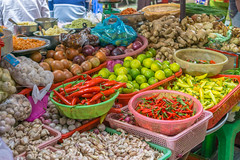 Vegetable Vendor at a Local Food Market in Saigon (wuestenigel) Tags: freshproducemarket chinatown saigon bowls tomato herbs pepper chili hochiminhcity lime vegetables colander vietnam ginger spices garlic onion
