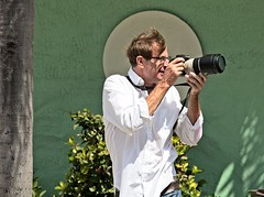 White Shirted photographer  102 (LarryJay99 ) Tags: pridefest2018 2018 lakeworth florida festival parade photographer men male man guy guys dude dudes canondslr canoncanon handsome handsomenen hairyarms streets streetstuff urbanimpressions urbannomads urbanites people urban container potted plant street furniture lauderdale gaypeople