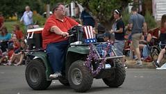 Ride (Scott 97006) Tags: guy man ride vehicle 4wheeler parade street independenceday