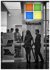 Microsoft ❤️ Linux (gro57074@bigpond.net.au) Tags: selectivecolor selectivecolour rain couple windowshopping f80 artseries sigma 105mmf14 d850 nikon spotcolor spotcolour cbd sydney pittstreetmall candidstreet streetphotography microsoft