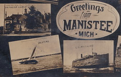 """NW Manistee MI RPPC Multiview Steamer Excursion Freighter and Master Schooner in Manisteer RIver Pierhead View Town Buildings and more1 (UpNorth Memories - Donald (Don) Harrison) Tags: vintage antique postcard rppc """"don harrison"""" """"upnorth memories"""" upnorth memories upnorthmemories michigan history heritage travel tourism restaurants cafes motels hotels """"tourist stops"""" """"travel trailer parks"""" cottages cabins """"roadside"""" """"natural wonders"""" attractions usa puremichigan """" """"car ferry"""" railroad ferry excursion boats ships bridge logging lumber michpics uscg uslss"""