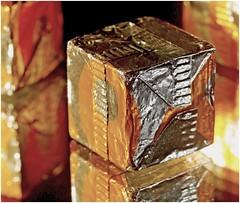 'O' for 'OXO' (jesse1dog) Tags: macromondays vowel gm1 extensiontube olympuszuikoomautomacro50mm 50mm tabletop mirror oxo chickenoxo oxocube orange silver aluminum metalfoil flaps