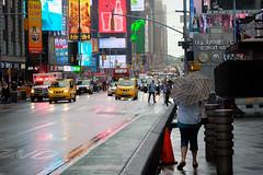Billboard rain (ho_hokus) Tags: 2018 42ndstreet fujix20 fujifilmx20 ny nyc newyork newyorkcity timessquare usa rain taxi billboard umbrella people pedestrian